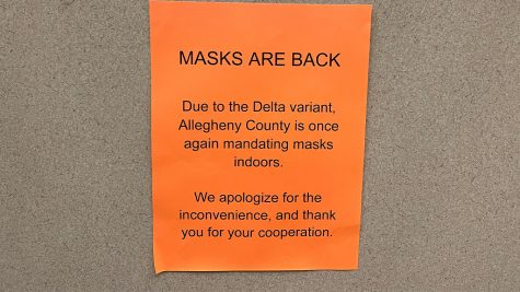 A sign in an elevator in the Student Center reminds people to wear masks amid the surge of new cases with the Delta variant.