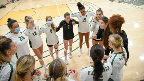 The women's volleyball team huddles together during the home match against IU East on Sept. 25.